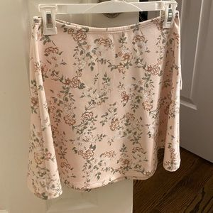 Pink mini skirt with flowers on it